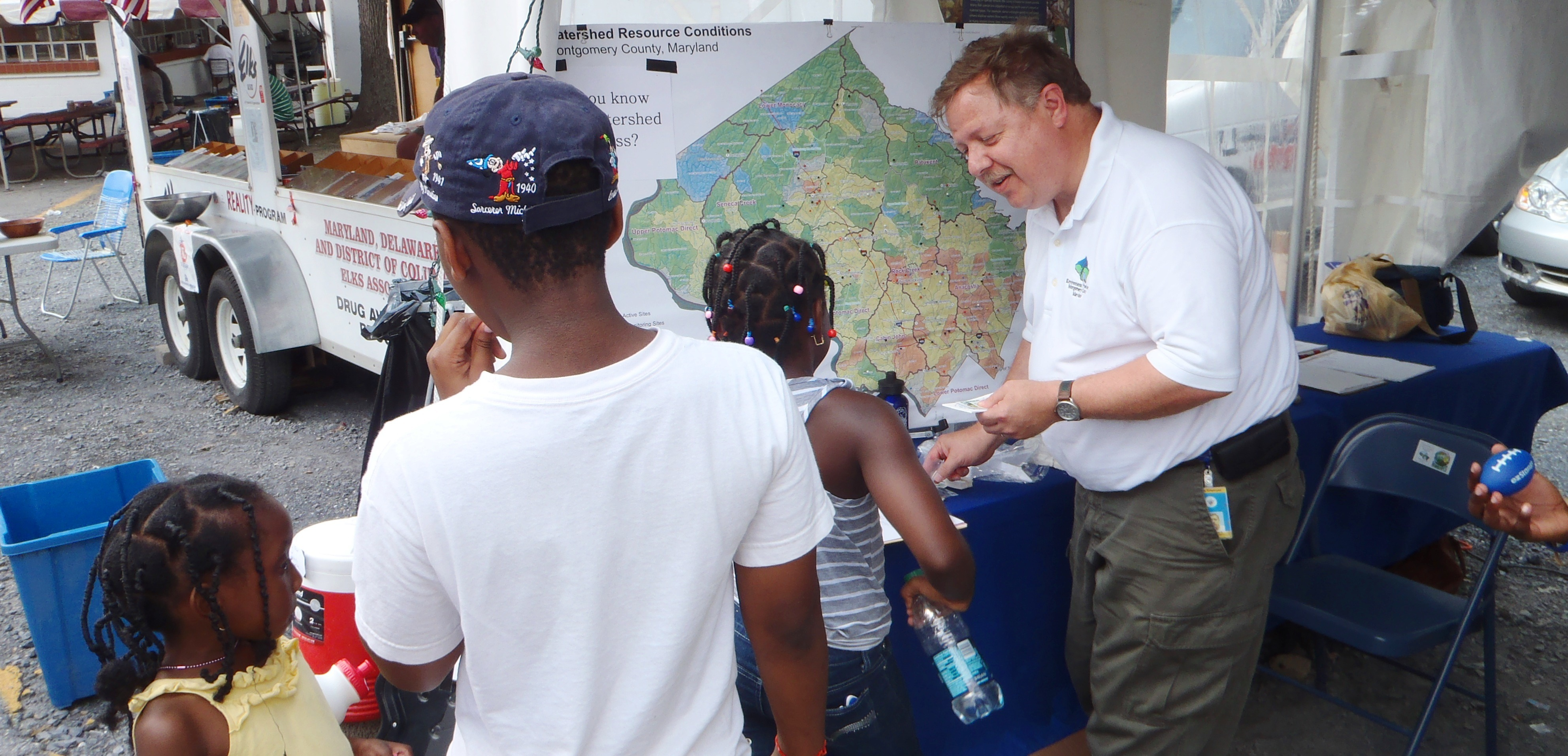 Image of Department of Environmental Protection staff member teaching kids about watersheds.