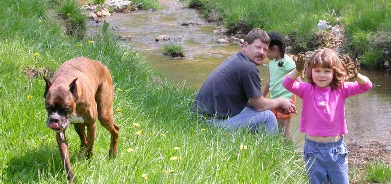 Photo of Montgomery County Department of Environmental Protection staff and family during a trash pick-up retreat.