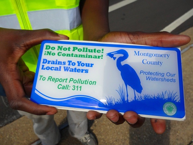 Image of a Do Not Pollute storm drain marker.