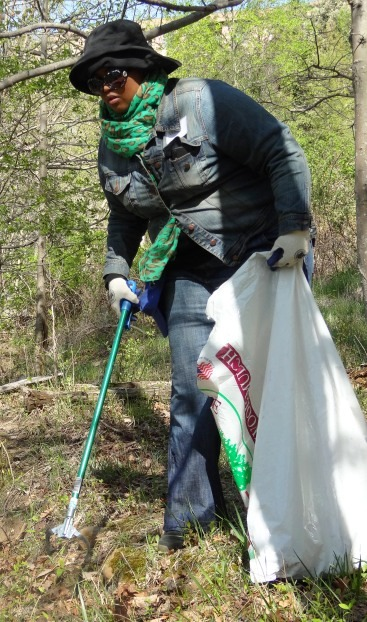 Image of volunteer picking up trash at the White Oak Earth Day Cleanup.
