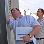 Photo of energy auditors performing a home energy checkup.