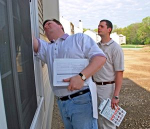 Image of contractors performing a quick home energy checkup.