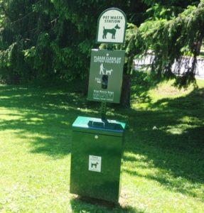 Image of pet waste station in a park