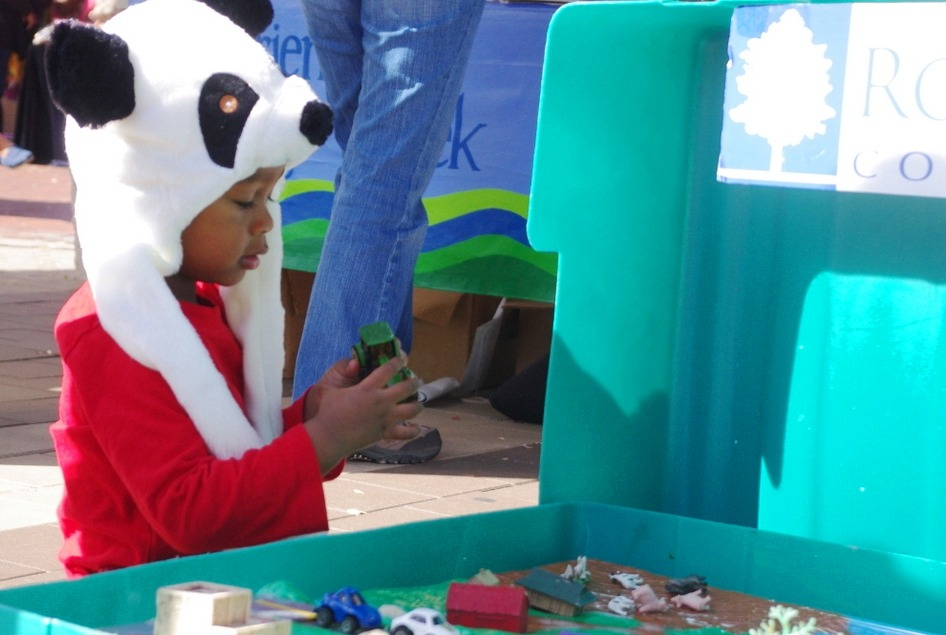 Image of a child playing with educational tools at the Silver Spring GreenFest 2012.
