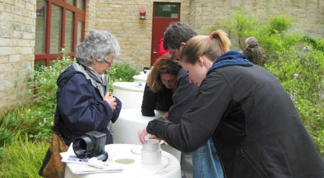 Image of workshop attendees assembling a rain barrel.