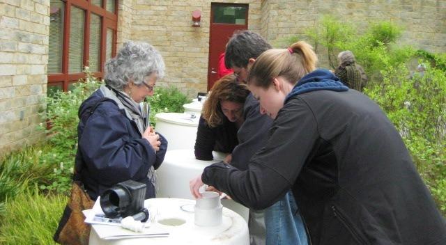 Image of workshop attendees assembling a rain barrel.