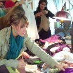Image of people participating in a Center for a New American Dream clothing swap.