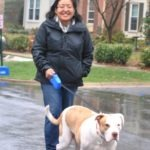 Image of woman walking dog.