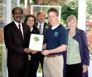 Image of A.I.R. Lawn Care receiving their green business certification