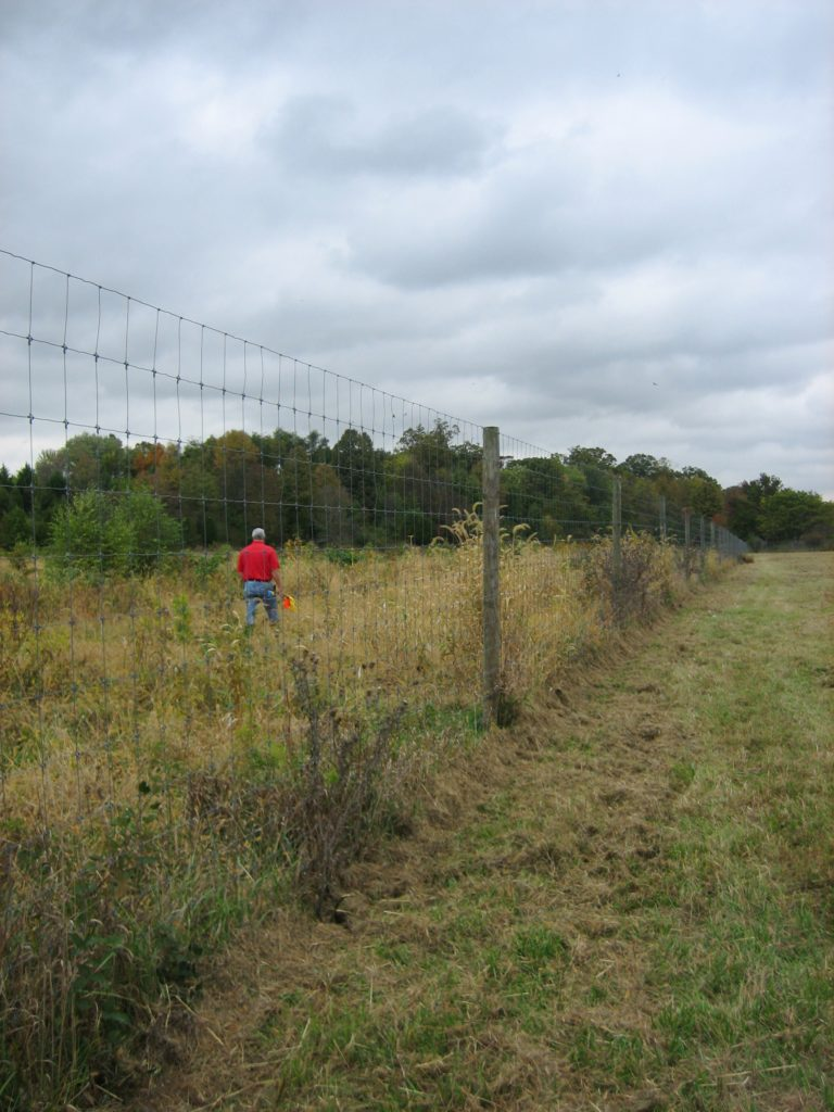 Image of the fence at the Oaks Planting