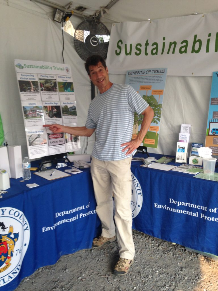 Image of the Office of Sustainability table and the trivia board.