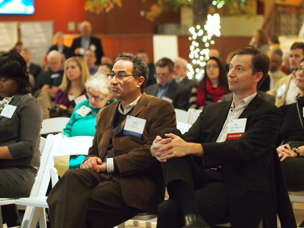 Attendees listen to opening remarks