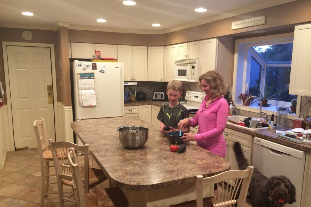A photo of Sean Boyle's wife and son in their newly lit kitchen