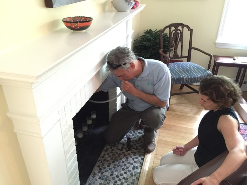 Image of a man performing an energy audit in a Takoma Park resident's house