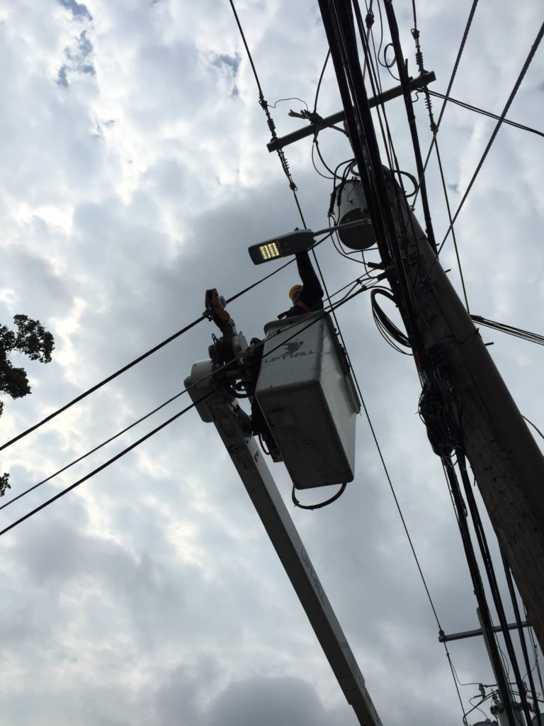 Man fixing utility pole