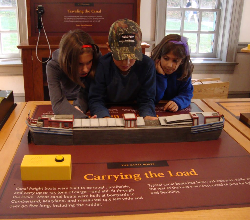 Kids looking at an exhibit