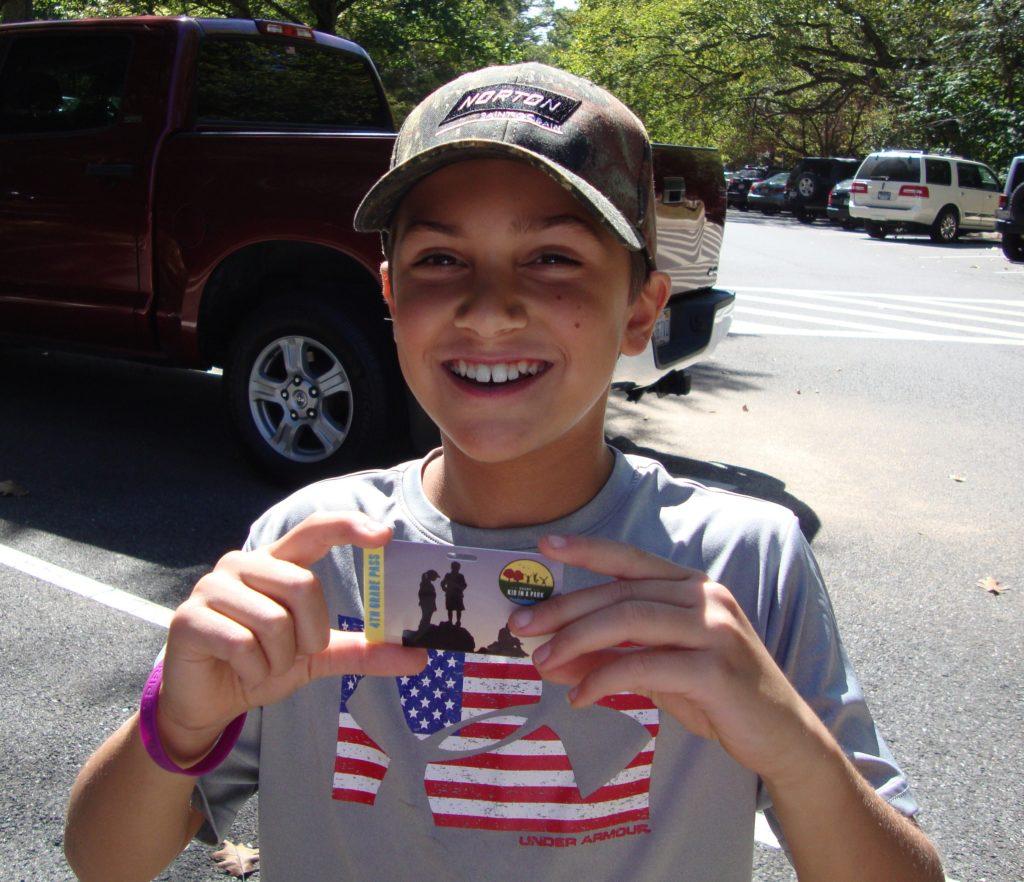 Jason holding his 4th grade park pass