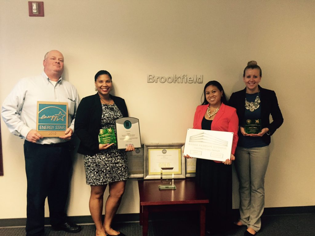 Brookfield management team accepting awards