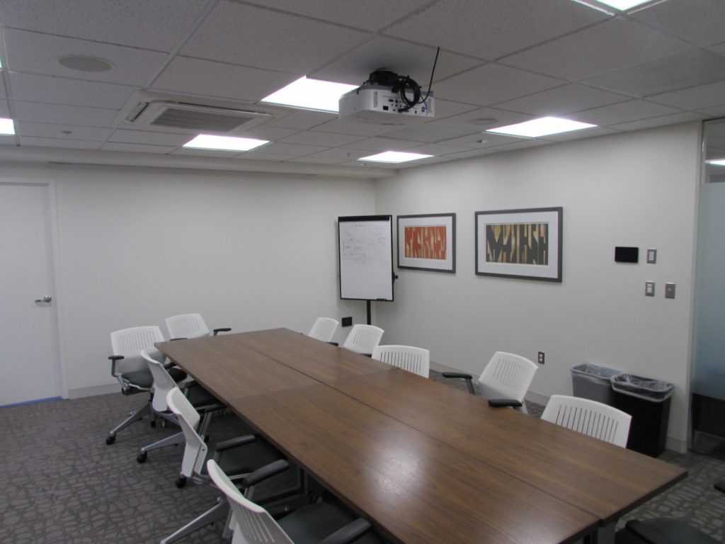 A conference room with updated lighting in 51 Monroe St.