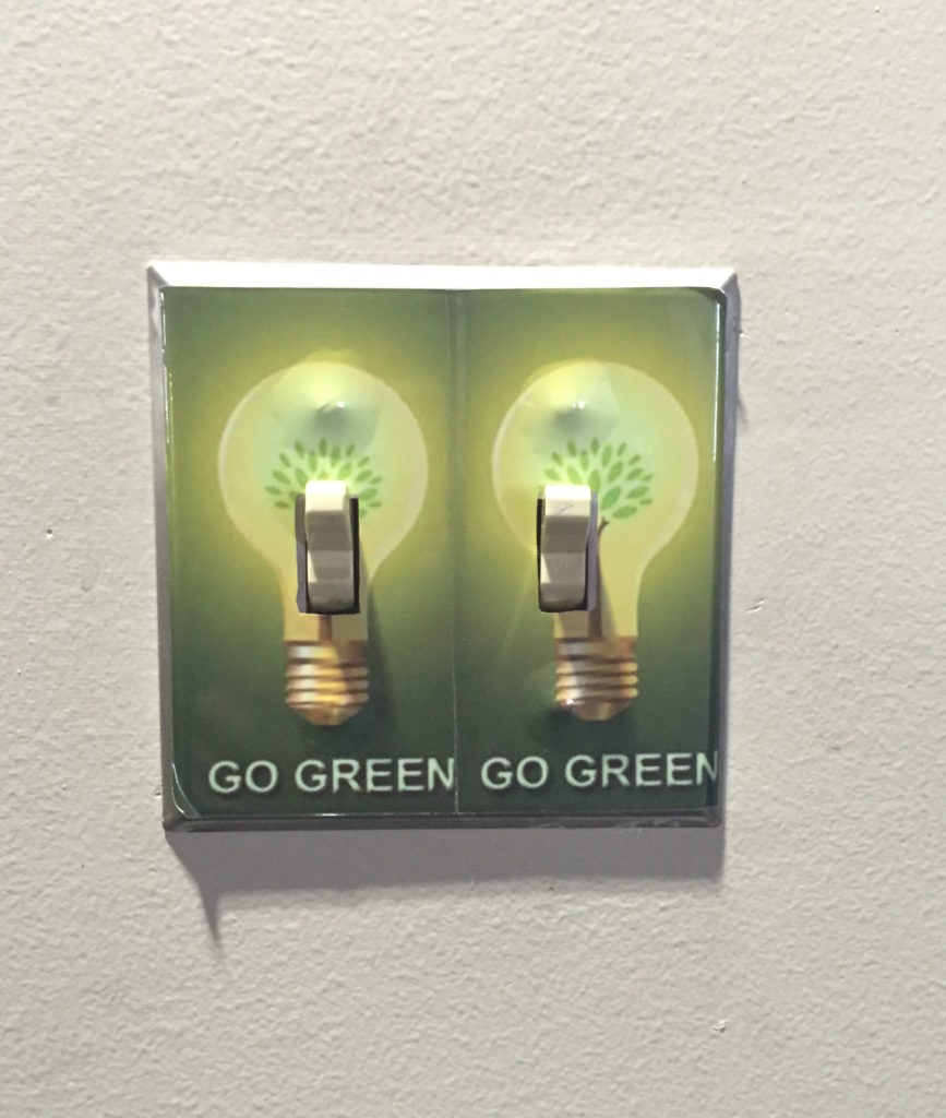 Signs reminding people to turn off lights in the office