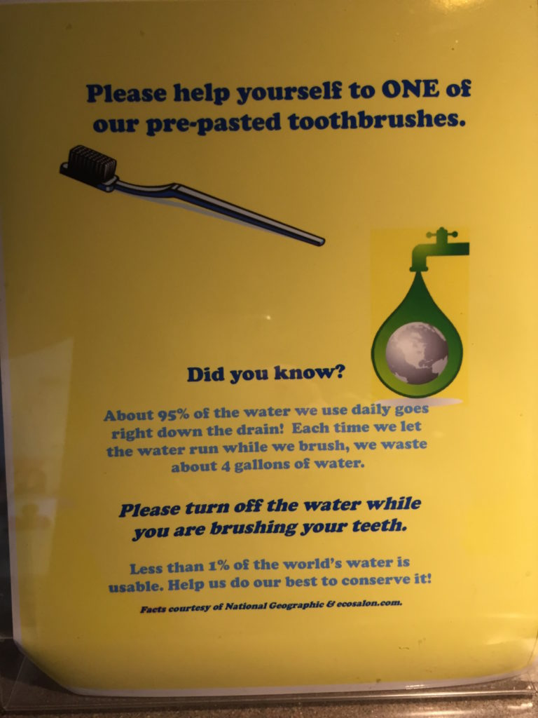 A sign that instructs patients to save water while brushing their teeth