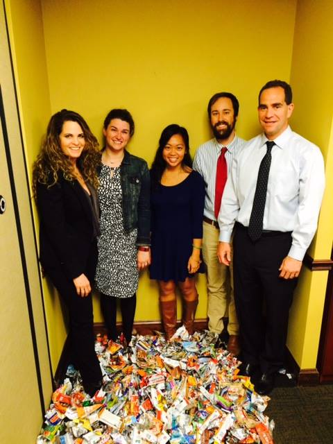 Family & Nursing Care staff stand beside their pile of 810 energy bar wrappers.