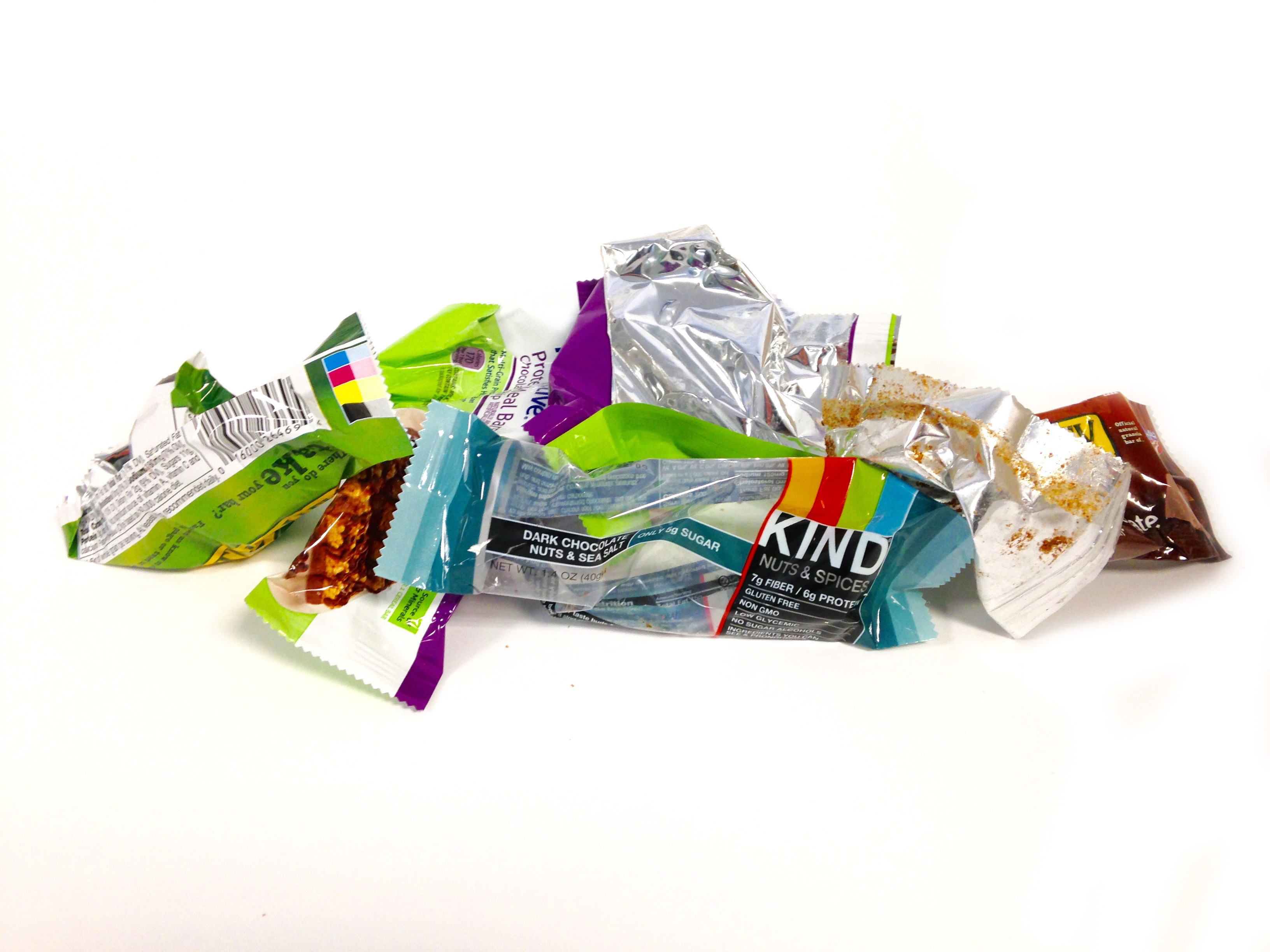 A Pile Of Granola And Energy Bar Wrappers
