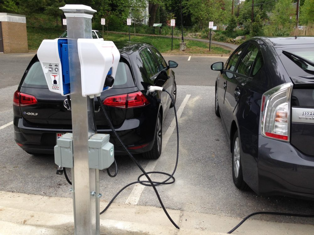 Two vehicles plugged into the electric vehicle charging stations