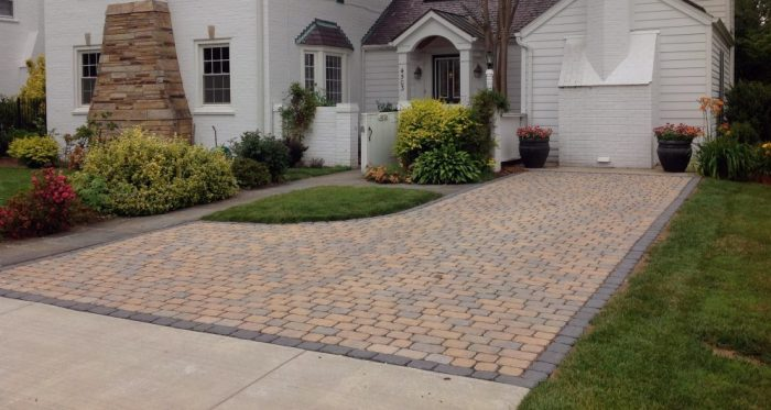 Patterned driveways made from permeable pavers can provide a nice aesthetic to homes.