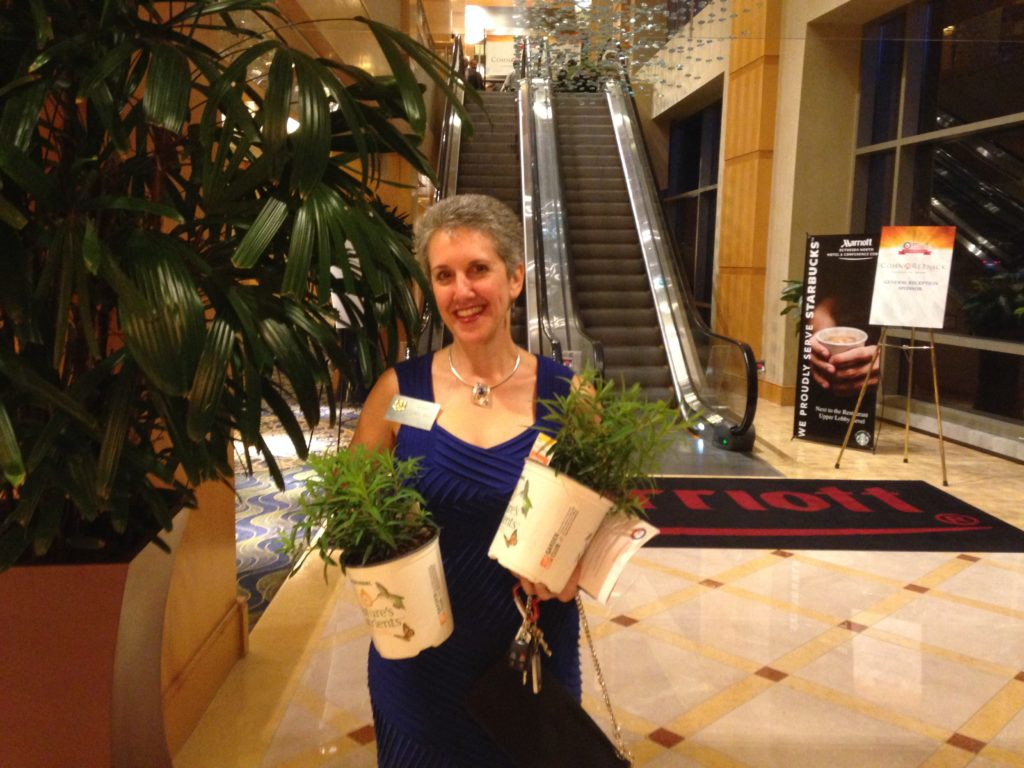 State Senator Cheryl Kagan, District 17, with milkweed plants received at the Montgomery County Chamber of Commerce's annual dinner