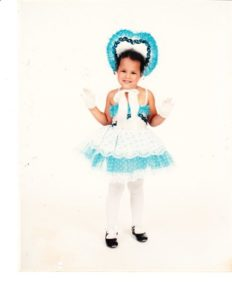 Larissa Johnson as a toddler in a dance outfit.