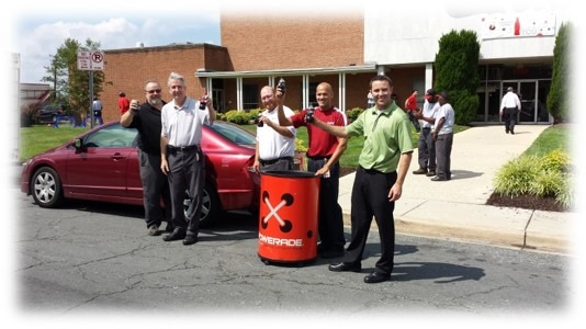 Management Staff of Coca-Cola distributing free Coke products at a Community Engagement Event at the Silver Spring Production Facility.