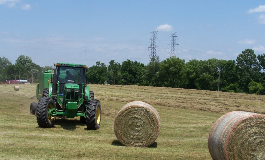 A win-win situation at the Montgomery County Composting Facility in which a local farmer bales and removes hay for free, saving the County money from mowing and maintaining the fields while generating revenue for the farmer.