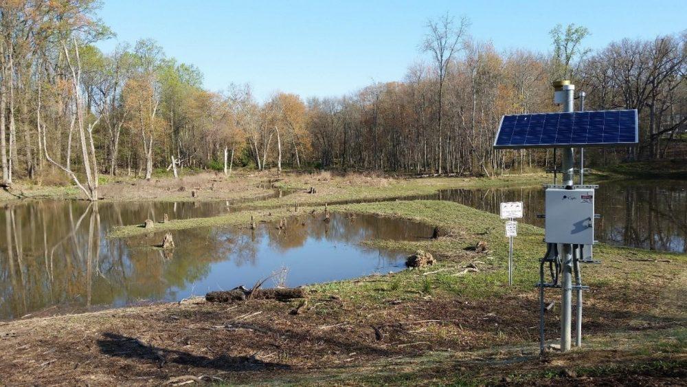 University Blvd wet pond with solar powered CMAC control panel