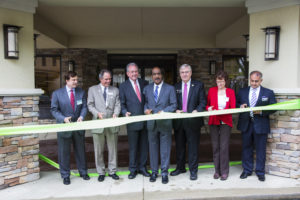 "County Executive Ike Leggett presiding over the first completed commercial clean energy project in Maryland's ""green"" ribbon-cutting."