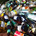 Glass bottles are seen in a recycling bin at a transfer station.