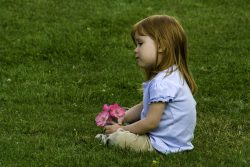 Child sitting in the grass